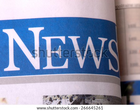 a newspaper with news related text - stock photo