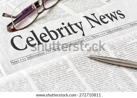 A newspaper with the headline Celebrity News - stock photo