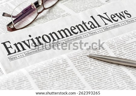 A newspaper with the headline Environmental News - stock photo