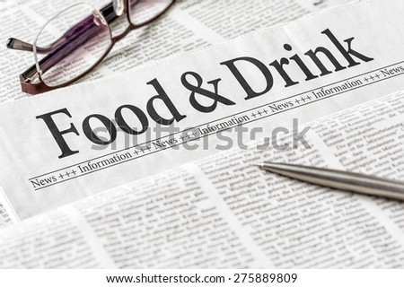 A newspaper with the headline Food and Drink - stock photo