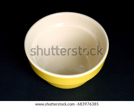 A nice afternoon tea cup on a black background.