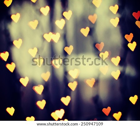 a nice background with defocused lights blurred into the shape of hearts good for holidays like valentine's day or wedding announcements or romantic cards - stock photo