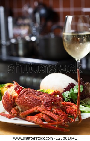 A nice, big plate filled with lobster, rice and a glass of white wine. - stock photo