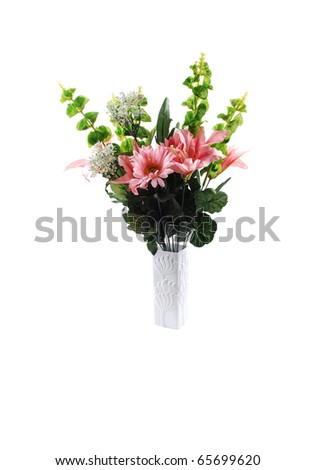 A nice bunch of silk lilies with some green branches in a white vase for white background. - stock photo