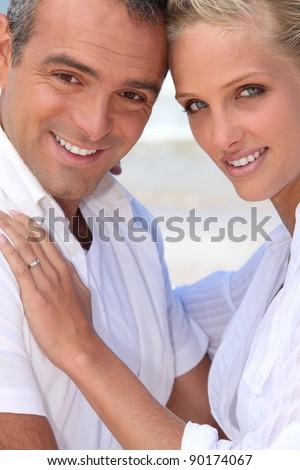 A nice couple by the beach. - stock photo