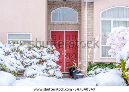A nice entrance of a luxury house in Vancouver, Canada with snow winter at Christmas.
