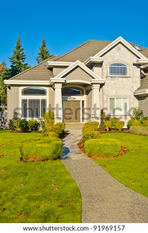 A nice entrance of a luxury house over blue sky and outdoor landscape - stock photo
