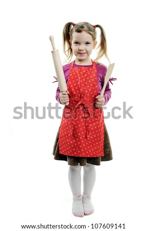 A nice girl with wooden kitchen tools in her hands - stock photo