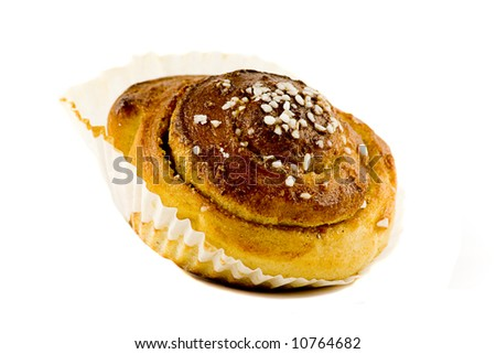 A nice homemade cinnamon roll isolated on white, including a clipping path for easy editing. - stock photo