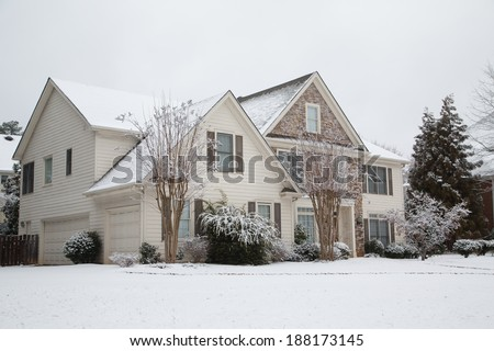 A nice house after a snow storm - stock photo