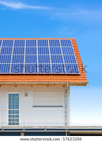 a nice house with solar panels - stock photo