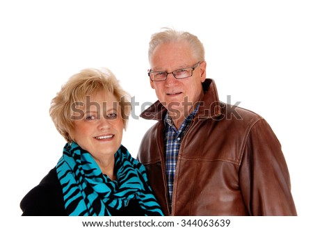 A nice older couple standing isolated for white background, theman in a brown leather jacket. - stock photo