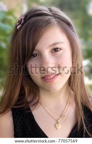 A nice portrait of a pretty girl outdoors - stock photo