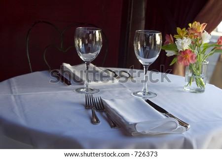 A nice semi-formal table setting. - stock photo