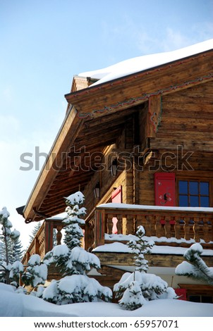A nice skiing chalet with the evening light. - stock photo