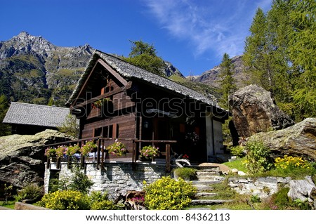 a nice view of a chalet - stock photo