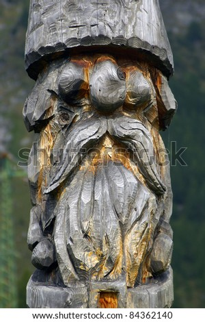 a nice view of a gnome made of wood - stock photo