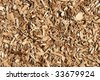 A nice wood chips mulch texture background. - stock photo