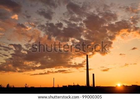 A nickel plant with sunset as background - stock photo