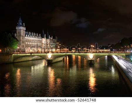A night capture of the Conciergerie, adjacent to the River Seine, Paris, France