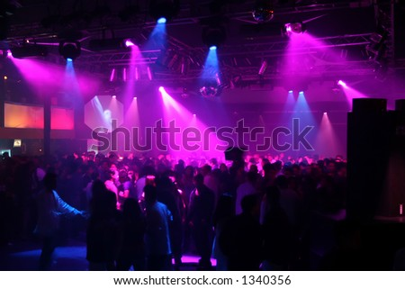 A night club concert scene with purple lights. - stock photo
