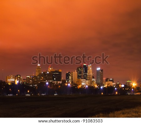 A night image of Kansas City, Missouri taken on December 18th, 2011.  The cloud cover held in the glow of the city lights.  Kansas City, Missouri is the largest city in the state of Missouri. - stock photo