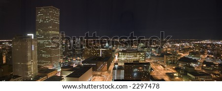 A night panorama of the Denver downtown core including the Colorado State Capitol. - stock photo
