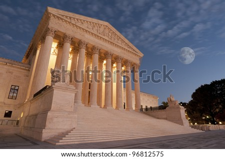 A night shot of the front of the US Supreme Court in Washington, DC. - stock photo