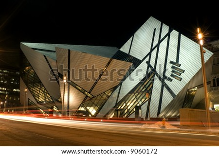 A night shot of the north face of the Royal Ontario Museum in Toronto, Canada, showing the new Michael Lee-Chin Crystal extension designed by Daniel Libeskind. - stock photo