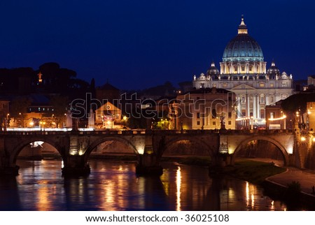 A night shot of the Tiber River with St Peter's Cathedral in the background, Rome, Italy
