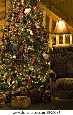 A night time view of a cozy room at Christmas time. - stock photo