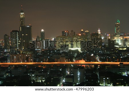 A night view of Baiyoke Sky hotel and the modern district around it in Bangkok (Thailand). Baiyoke Sky hotel is largest skyscraper in Bangkok