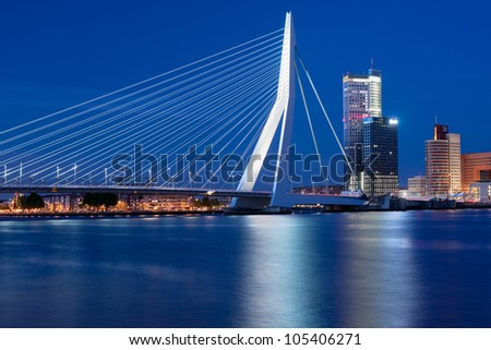 A night view on Erasmus bridge over the Nieuwe Maas river in Rotterdam, Netherlands. GPS information is in the file - stock photo