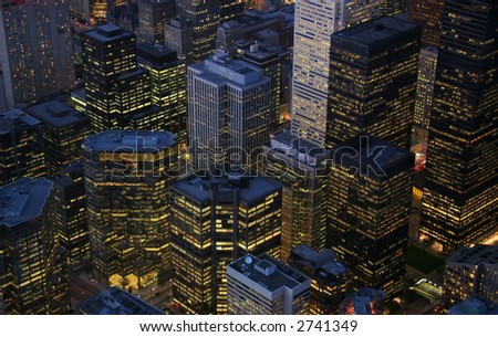 A nightime view of illuminated skyscrapers in the financial district of Toronto, Ontario. (Canada)