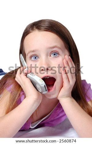 A nine year old girl talking on a cell phone. - stock photo