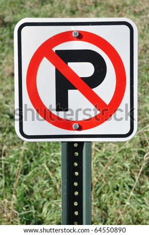 A No Parking Sign on a Sunny Day - stock photo