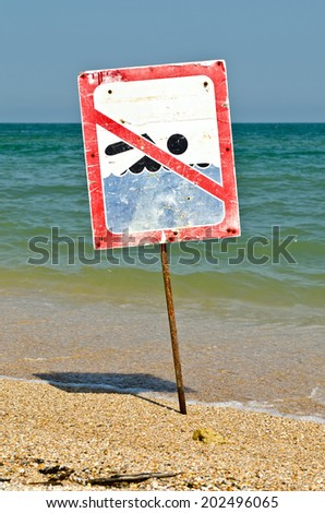 A no swimming danger sign at the beach - stock photo