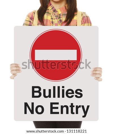 A non-recognizable student holding a sign against bullying - stock photo