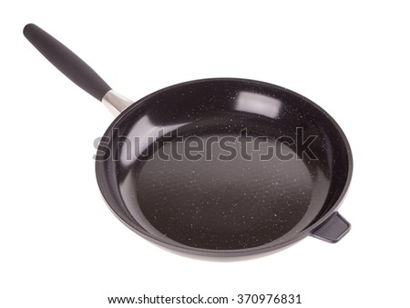 A non-stick frying pan with detachable handle isolated on white background - stock photo