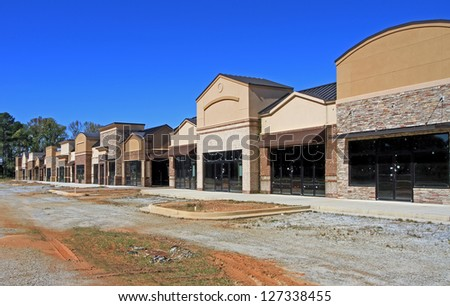 A North American shopping center sits unfinished, a sign of poor economic times. - stock photo