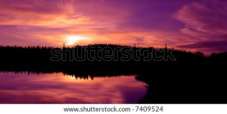 a northern sunset on a calm autumn's night - stock photo