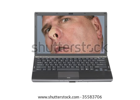 A nosy man pressed his face against a laptop screen being nosy and meddlesome.  Image was shot against a lighted white background and is not a cutout.