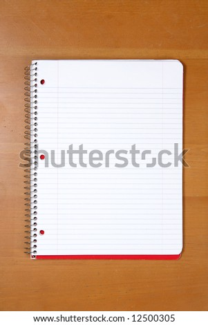 A note book on a desk in an office - stock photo