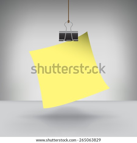 A Note Hung by a Binder Clip - stock photo