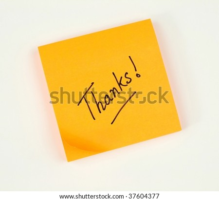 A note of thanks scribbled on a bright color sticky pad - stock photo