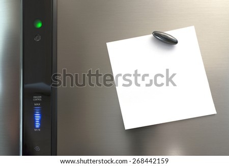 A note on a silver refrigerator, held with a magnet. The note is blank for the buyer's own text. - stock photo