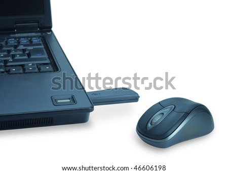 A notebook and a computer mouse over white