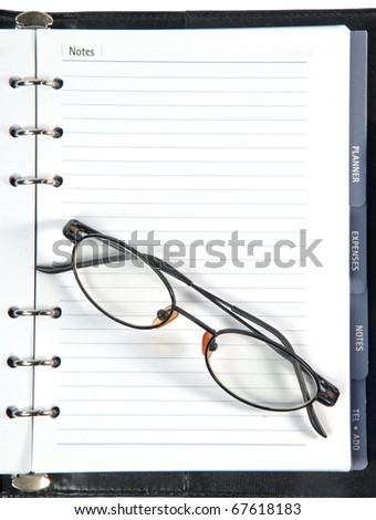 a notebook and pen isolated on white