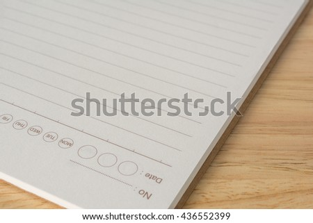 A notebook on the wooden table.