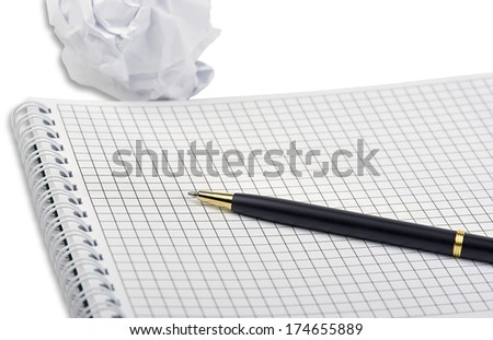 A notebook with ballpoint pen and crumpled paper isolated on a white background with light shadow. - stock photo